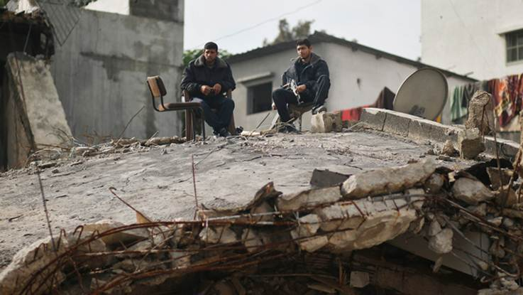 Credit Reuters -- Hamas policemen sit atop their destroyed headquarters in Gaza City November 25, 2012.